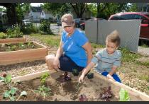 Brenda Wallace and her son hard at work in HAP's new community garden at 233 Tyler Street in Springfield's Old Hill neighborhood.